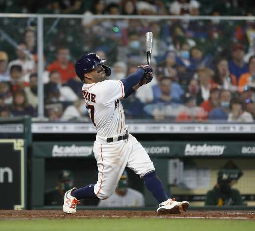 Houston Astros Jose Altuve (27) flies out during the fifth inning of an MLB baseball game at Minute Maid Park, in Houston, Saturday, April 10, 2021. Photo: Karen Warren/Staff Photographer / @2021 Houston Chronicle