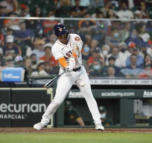 Houston Astros Aledmys Diaz (16) singles during the fourth inning of an MLB baseball game at Minute Maid Park, in Houston, Saturday, April 10, 2021. Photo: Karen Warren/Staff Photographer / @2021 Houston Chronicle
