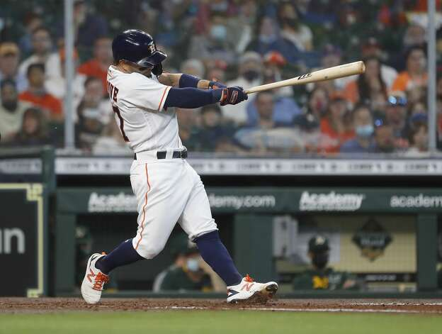 Houston Astros Jose Altuve (27) doubles off Oakland Athletics starting pitcher Frankie Montas during the third inning of an MLB baseball game at Minute Maid Park, in Houston, Saturday, April 10, 2021. Photo: Karen Warren/Staff Photographer / @2021 Houston Chronicle