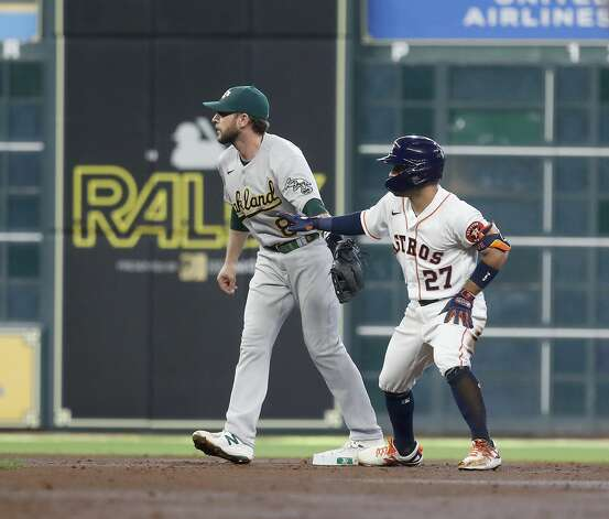 Houston Astros Jose Altuve (27) stands on second base after doubling off Oakland Athletics starting pitcher Frankie Montas during the third inning of an MLB baseball game at Minute Maid Park, in Houston, Saturday, April 10, 2021. Photo: Karen Warren/Staff Photographer / @2021 Houston Chronicle