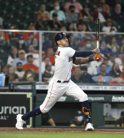 Houston Astros shortstop Carlos Correa (1) flies out during the third inning of an MLB baseball game at Minute Maid Park, in Houston, Saturday, April 10, 2021. Photo: Karen Warren/Staff Photographer / @2021 Houston Chronicle