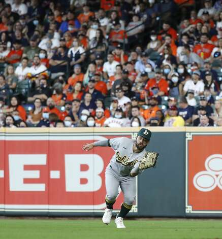 Oakland Athletics right fielder Ka'ai Tom (1) catches Houston Astros Myles Straw's fly out during the third inning of an MLB baseball game at Minute Maid Park, in Houston, Saturday, April 10, 2021. Photo: Karen Warren/Staff Photographer / @2021 Houston Chronicle