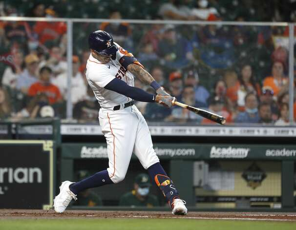 Houston Astros Carlos Correa (1) hits a single during the first inning of an MLB baseball game at Minute Maid Park, in Houston, Saturday, April 10, 2021. Photo: Karen Warren/Staff Photographer / @2021 Houston Chronicle