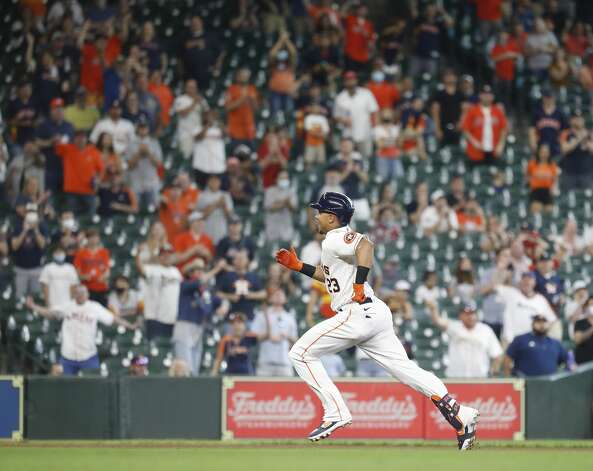 Houston Astros Michael Brantley (23) runs past second base on his way to third after hitting an RBI triple during the seventh inning of an MLB baseball game at Minute Maid Park, in Houston, Saturday, April 10, 2021. Photo: Karen Warren/Staff Photographer / @2021 Houston Chronicle