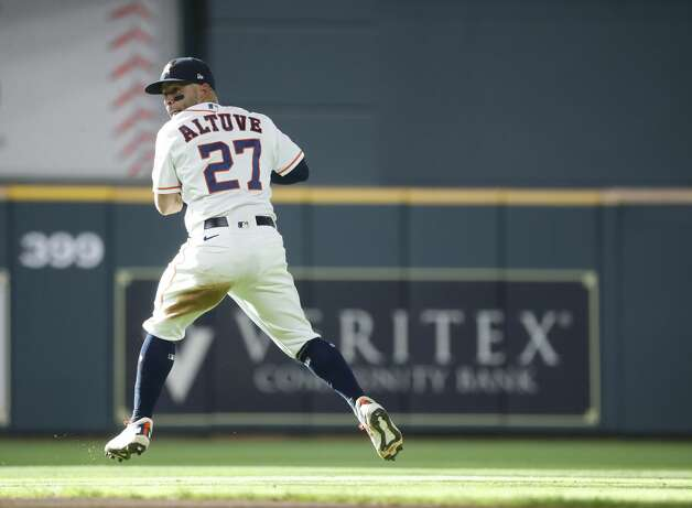 Houston Astros second baseman Jose Altuve (27) spins as he tries to field Oakland Athletics Ramon Laureano's single on the field during the ninth inning of an MLB baseball game at Minute Maid Park, in Houston, Saturday, April 10, 2021. Photo: Karen Warren/Staff Photographer / @2021 Houston Chronicle