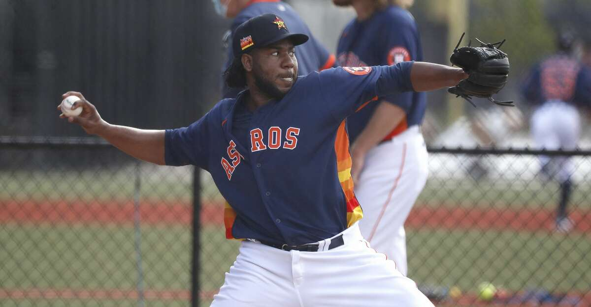Houston Astros pitcher Pedro Baez throws a bullpen session during the first full squad workouts for the Astros, in West Palm Beach, Florida, Monday, February 22, 2021.