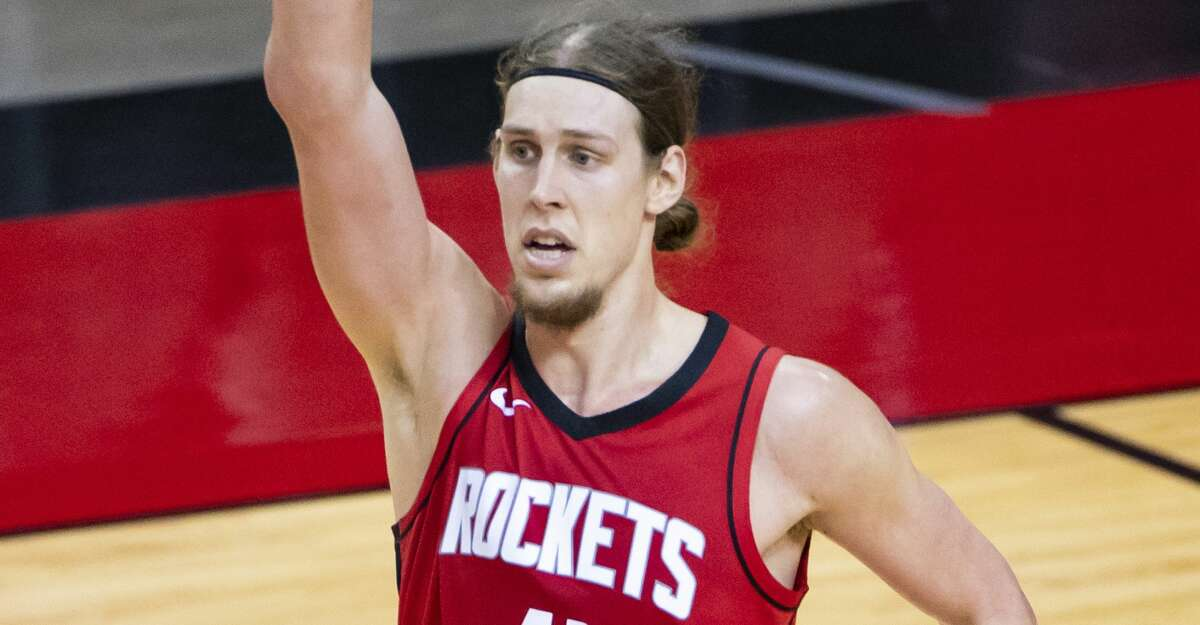 Houston Rockets forward Kelly Olynyk (41) celebrates a made shot during the second quarter of an NBA game between the Houston Rockets and Dallas Mavericks on Wednesday, April 7, 2021, at Toyota Center in Houston.