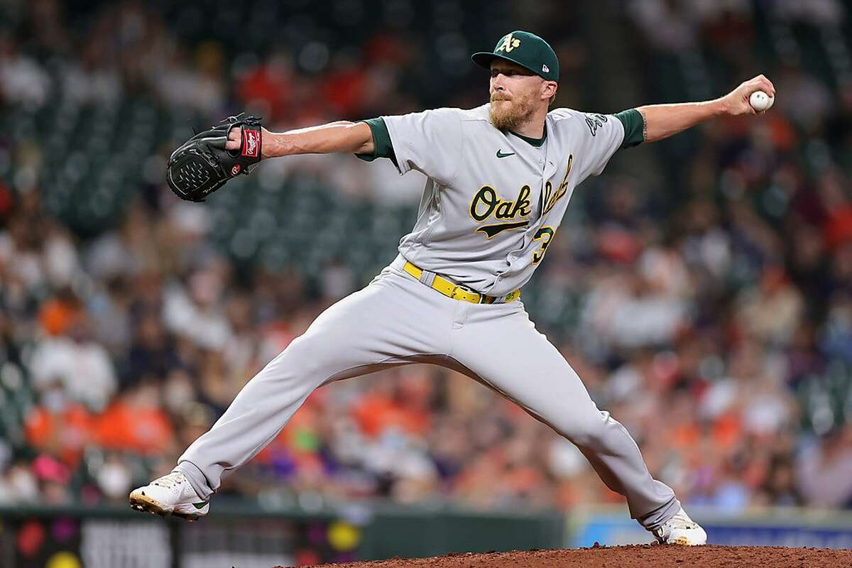 HOUSTON, TEXAS - APRIL 09: Jake Diekman #35 of the Oakland Athletics delivers a pitch during the ninth inning against the Houston Astros at Minute Maid Park on April 09, 2021 in Houston, Texas. (Photo by Carmen Mandato/Getty Images)