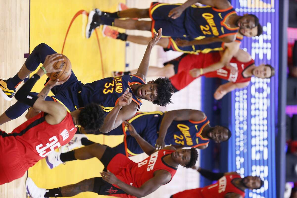 Golden State Warriors center James Wiseman (33) guards Houston Rockets center Christian Wood (35) in the first quarter of an NBA game at Chase Center, Saturday, April 10, 2021, in San Francisco, Calif.