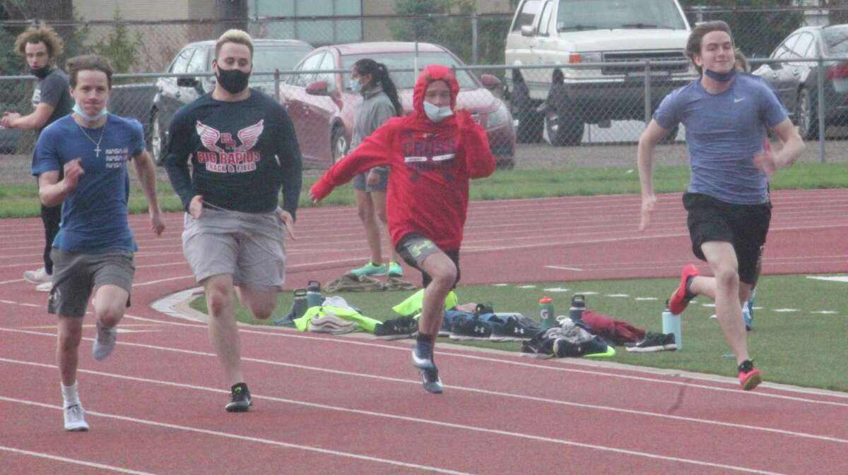 Big Rapids runners compete in time workouts at Top Taggart Field on Friday. (Pioneer photo/John Raffel)