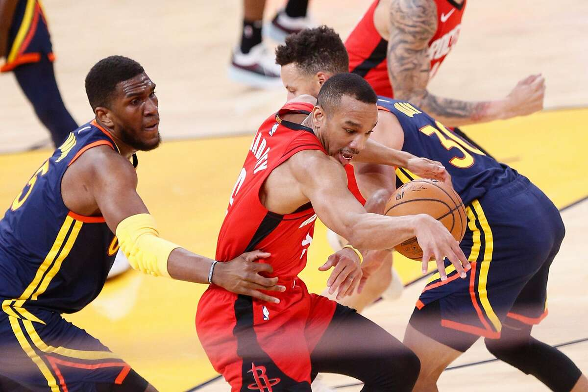 Golden State Warriors guard Stephen Curry (30) fouls Houston Rockets guard Avery Bradley (9) in the first quarter of an NBA game at Chase Center, Saturday, April 10, 2021, in San Francisco, Calif.