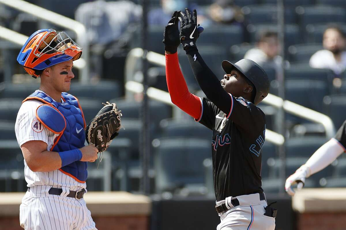 Marlins rookie Jazz Chisholm Jr. crosses home plate after homering off the Mets' Jacob deGrom.