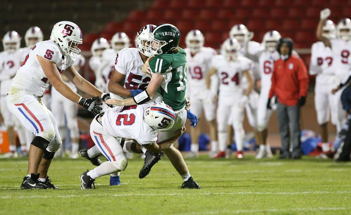 St. Ignatius senior linebacker Peter Quill sacks Sacred Heart Cathedral quarterback Cian Dowling on a key fourth down play late to sew up a 20-17 win on Friday in the Bruce-Mahoney football game at Kezar Stadium.