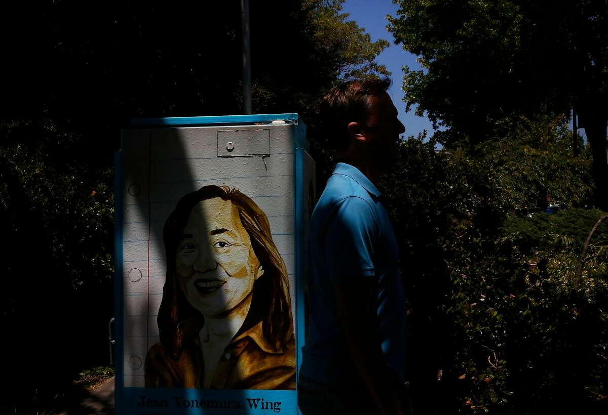The Arts and Humanities Academy's class of 2012 honored Jean Yonemura Wing, whose image is shown on a decorated utility box in 2017. The academy is located at Berkeley High School.