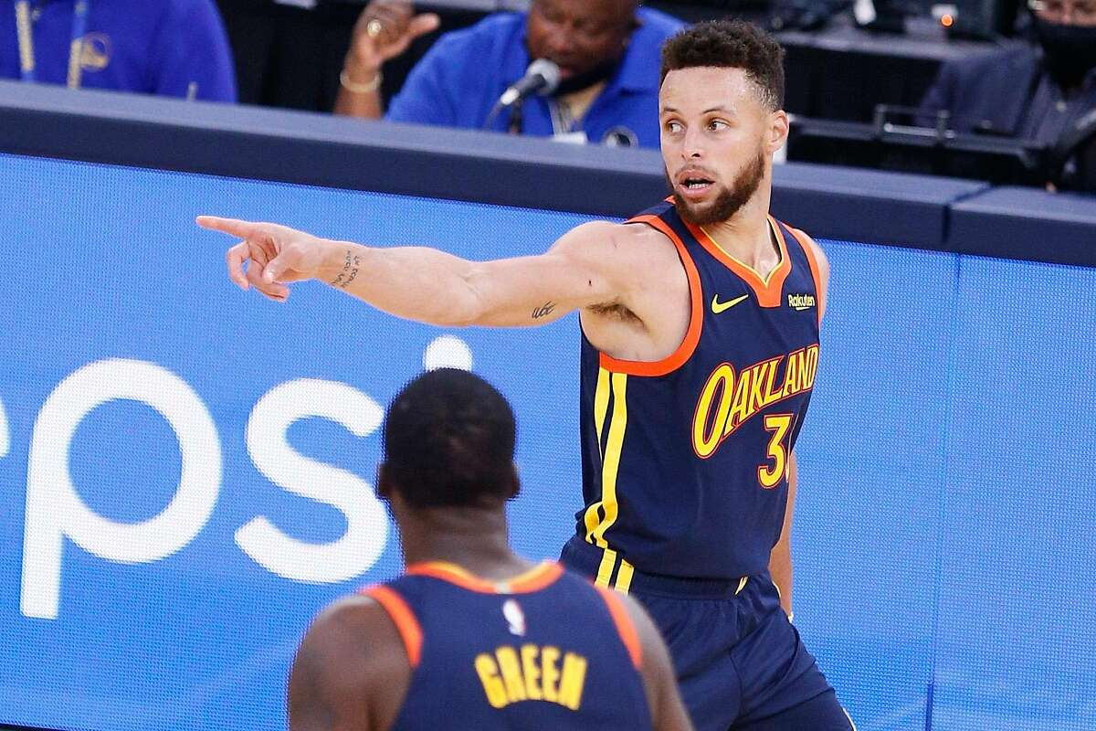 Golden State Warriors guard Stephen Curry (30) after scoring a three-point shot against the Houston Rockets in the third quarter of an NBA game at Chase Center, Saturday, April 10, 2021, in San Francisco, Calif.