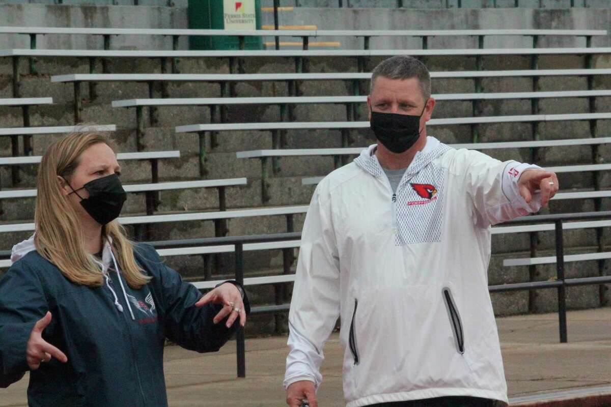 Big Rapids track and field coaches Michele (left) and her husband Mike Selzer get their athletes organized for a practice on Friday at Top Taggart Field. (Pioneer photo/John Raffel)