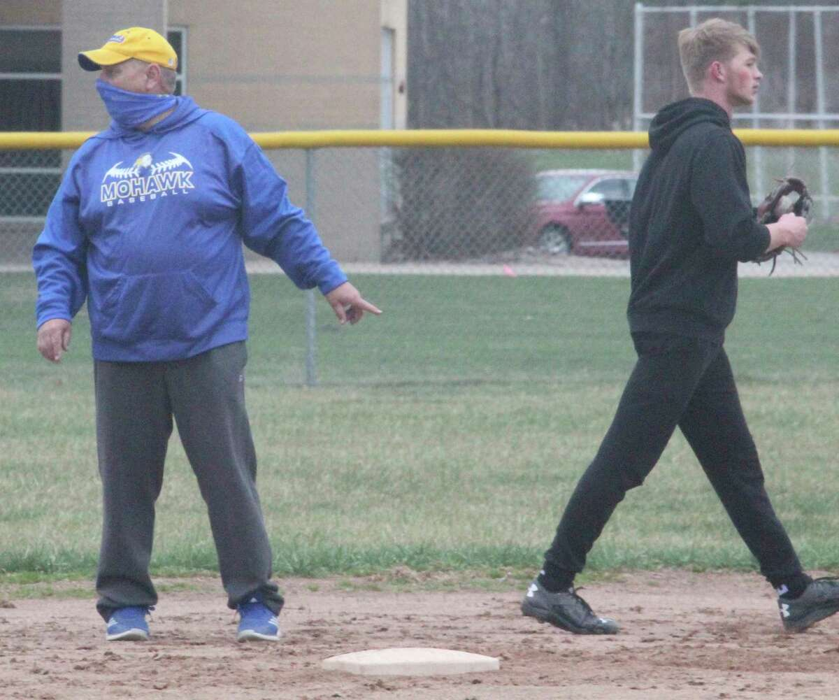 Morley Stanwood baseball coach Vern Smith (left) conducts practices on Friday. Earlier in the day, Gov. Gretchen Whitmer recommended a two-week pause in sports, but the MHSAA and local athletic officials indicated they are continuing with their schedules. (Pioneer photo/John Raffel)