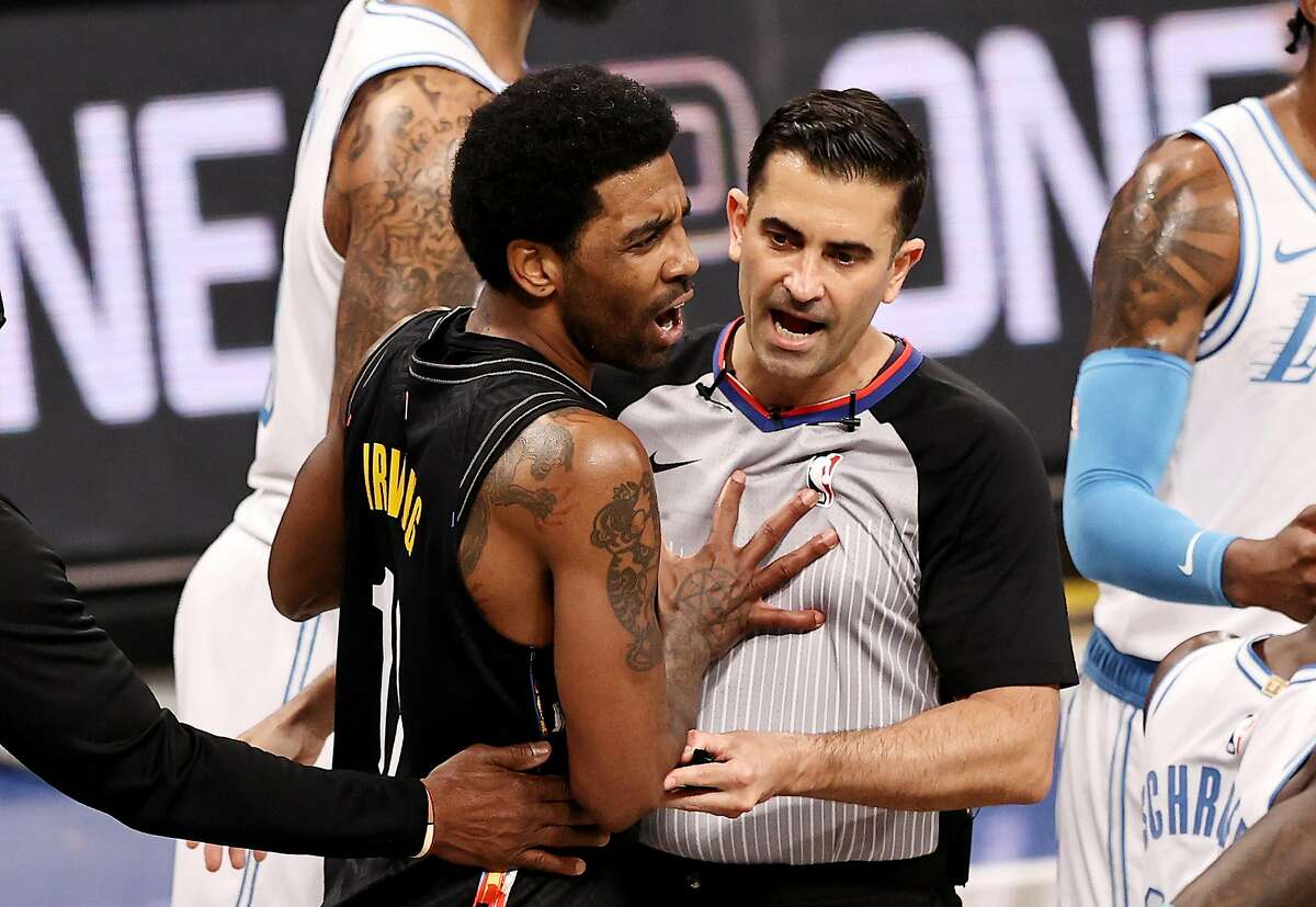 Brooklyn's Kyrie Irving reacts after he is ejected from the game as he shoves referee Zach Zarba out of the way.