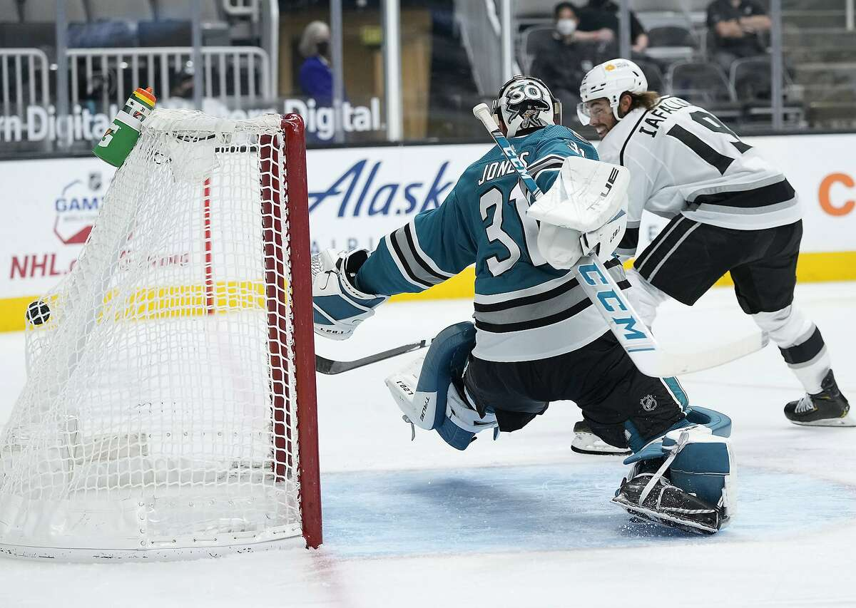 Sharks goaltender Martin Jones can't make the stop on a goal by Kings right wing Alex Iafallo during the second period.