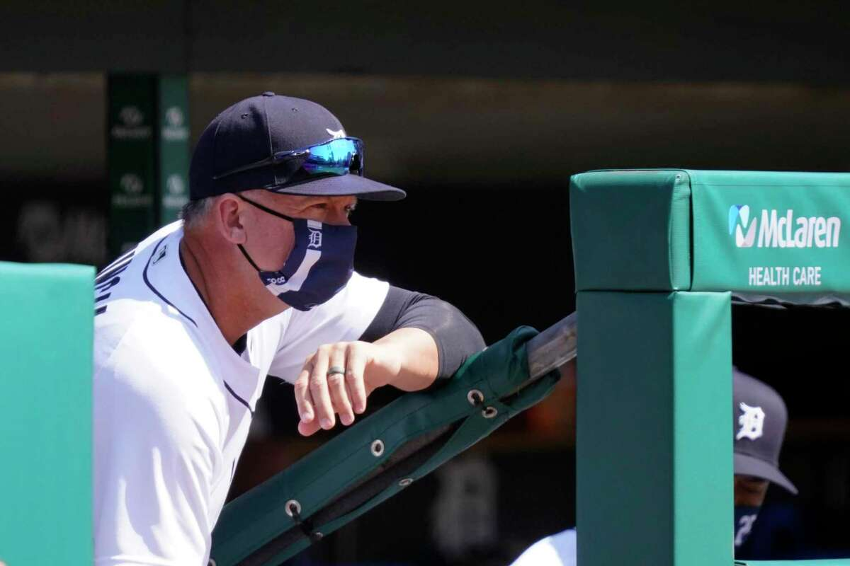 Detroit Tigers manager A.J. Hinch watches from the dugout during the second inning of a baseball game against the Cleveland Indians, Sunday, April 4, 2021, in Detroit. (AP Photo/Carlos Osorio)