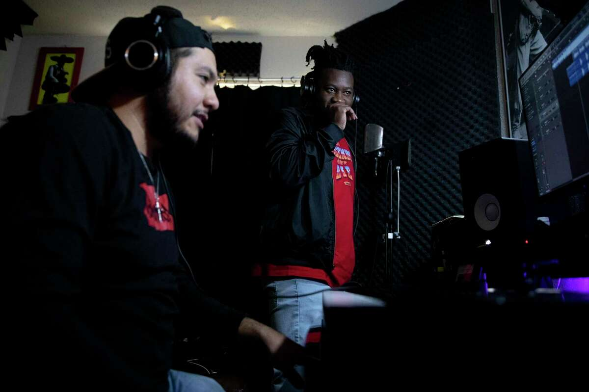 Jarrell Flowers smiles at producer Jacob Muñiz after finishing a verse on a song for an EP they plan to release in the summer.
