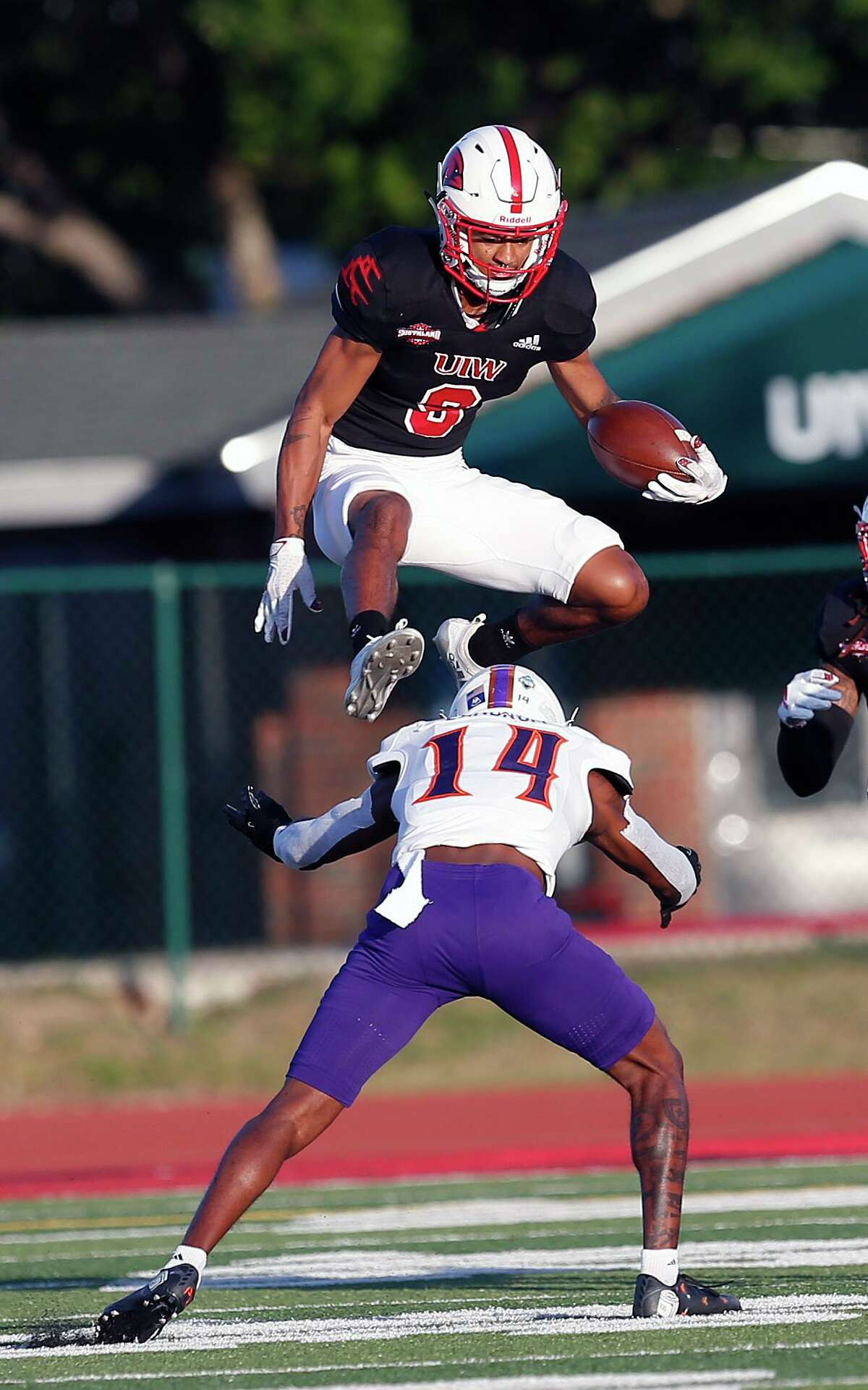 UIW Tre Wolf #9 leaps over Northwestern State Waylon Washington after a reception in first quarter. College Football UIW vs. Northwestern State on Saturday, April 10,2021 at UIW.