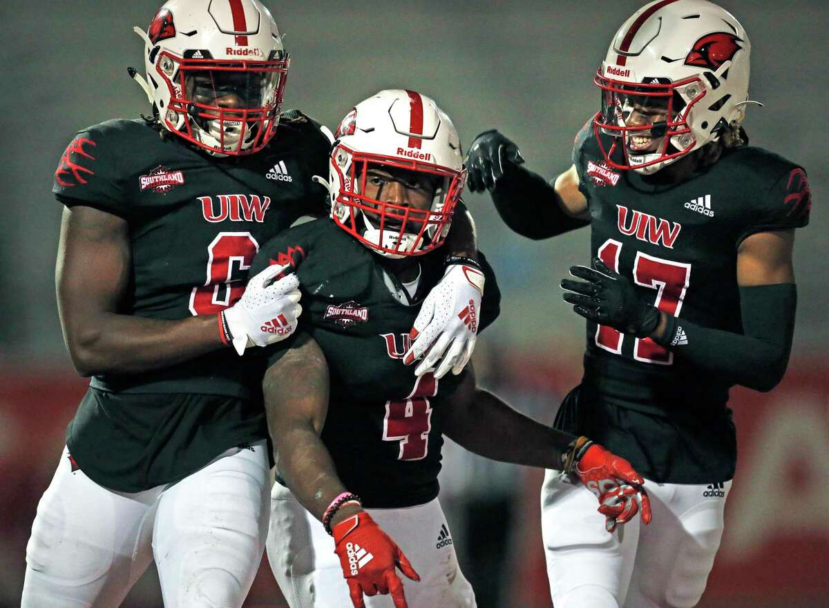 UIW Kevin Brown #4 is joined by Jayden Jones #6 and Mark Sullivan #17 after his touchdown in the second half. College Football UIW vs. Northwestern State on Saturday, April 10,2021 at UIW.
