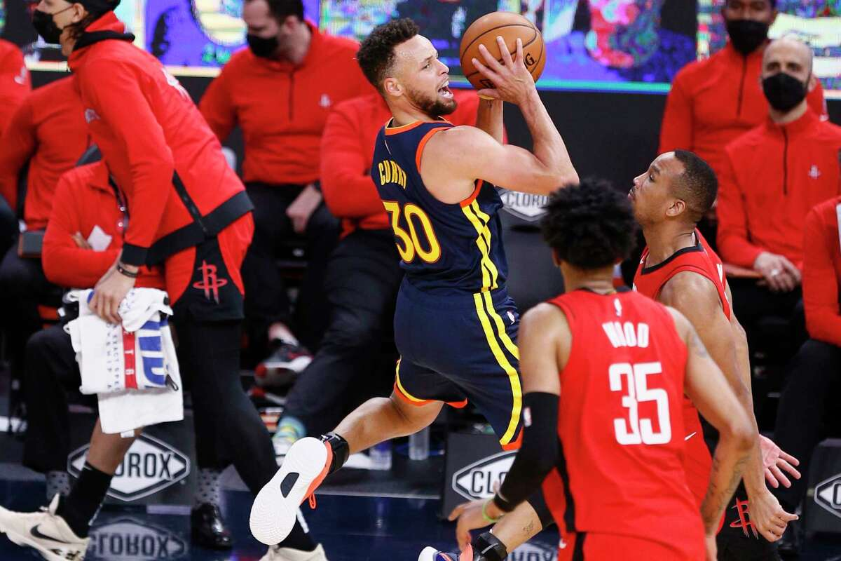 Golden State Warriors guard Stephen Curry (30) is fouled outside the three-point line in the third quarter of an NBA game against the Houston Rockets at Chase Center, Saturday, April 10, 2021, in San Francisco, Calif.