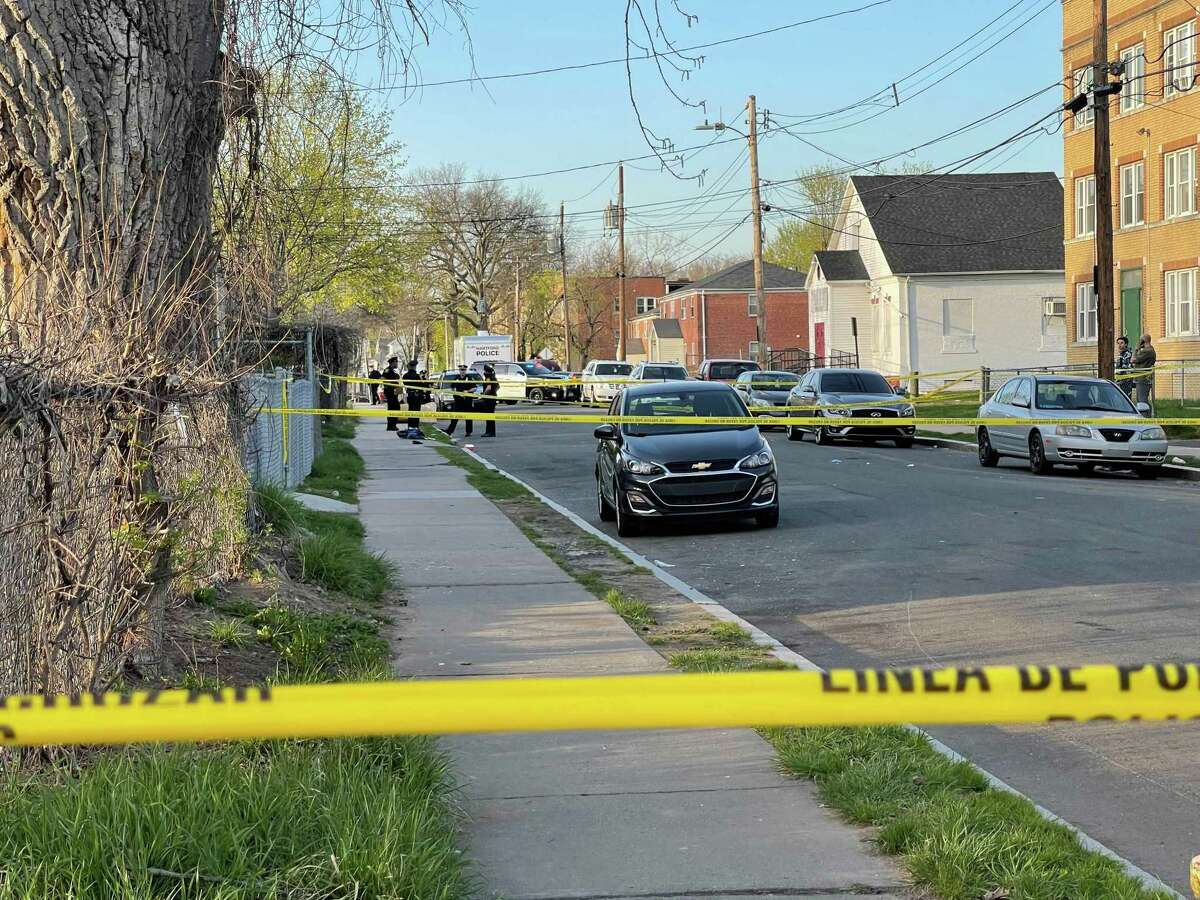 Hartford police officers and detectives gathered at the scene of a shooting on Magnolia Street in April. Jamari Preston, 16, of New Britain was killed in the shooting.