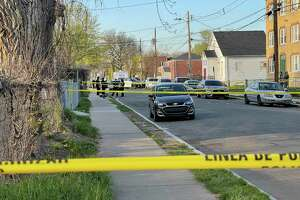 Hartford police officers and detectives gathered at the scene of a shooting on Magnolia Street Saturday. Jamari Preston, 16, of New Britain was killed in the shooting.