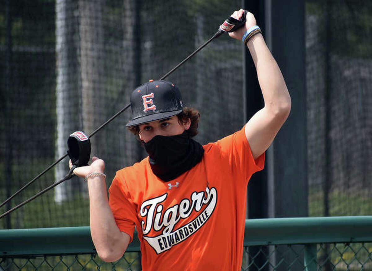 Edwardsville outfielder Ty Berumen stretches prior to practice Tuesday at Tom Pile Field in Edwardsville.