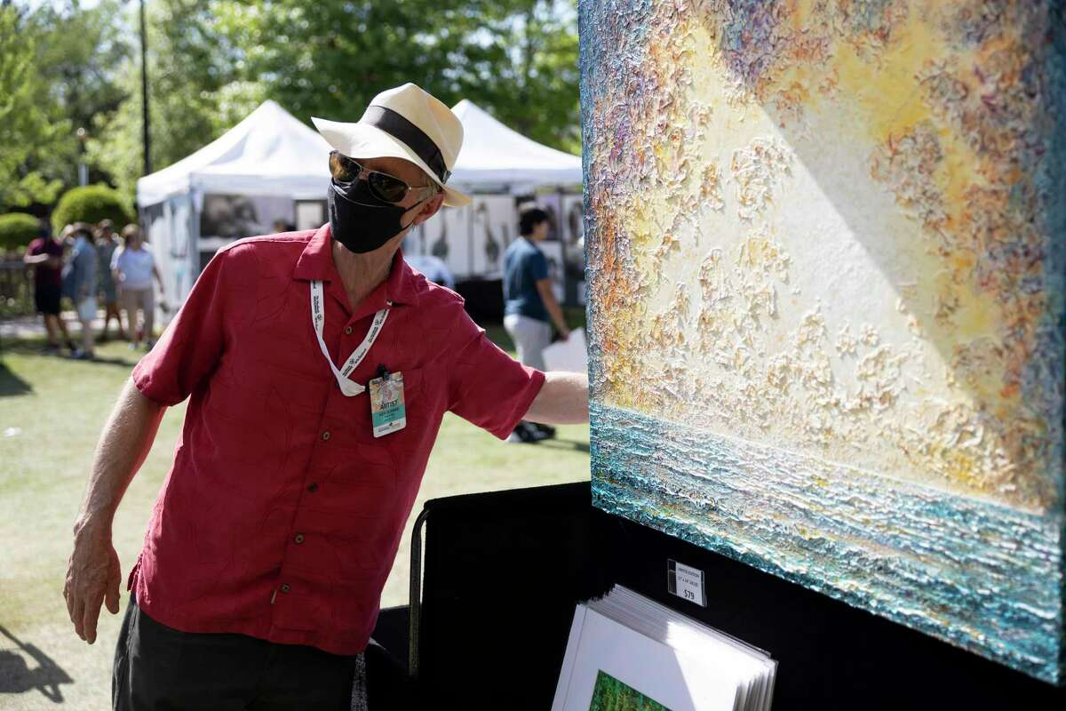 Ken Bonner, painter, speaks about his work during The Woodlands Waterway Arts Festival.