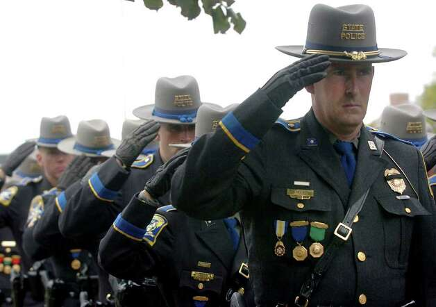 Connecticut State Police officers salute during the funeral