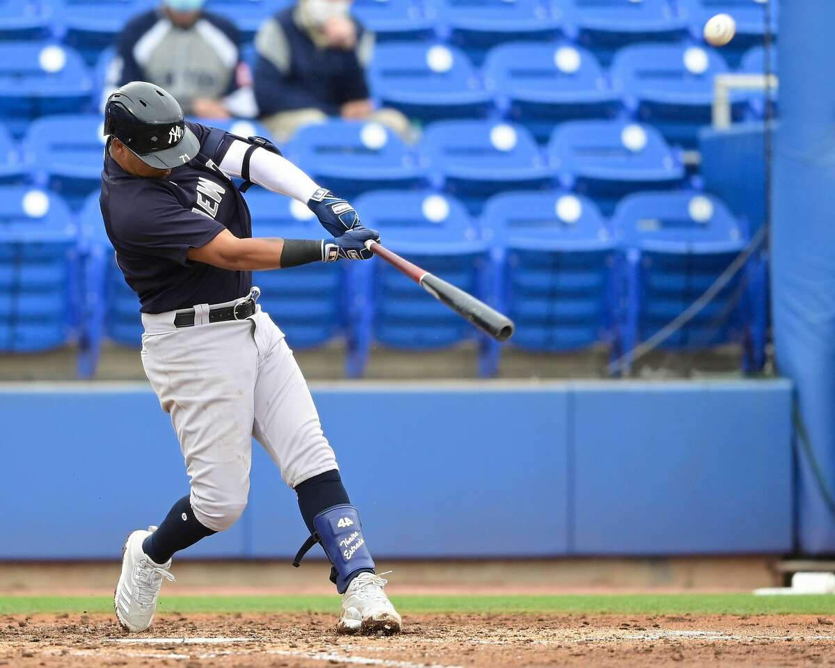 DUNEDIN, FLORIDA - MARCH 21: Thairo Estrada #71 of the New York Yankees hits a three run home run during the third inning against the Toronto Blue Jays during a spring training game at TD Ballpark on March 21, 2021 in Dunedin, Florida. (Photo by Douglas P. DeFelice/Getty Images)