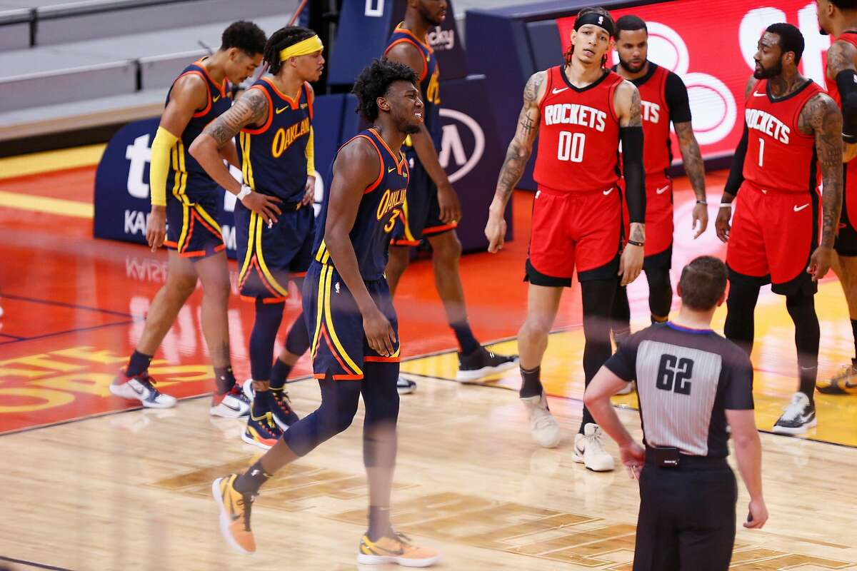 Golden State Warriors center James Wiseman (33) reacts after landing on the floor when his dunk attempt was blocked by Houston Rockets Kenyon Martin Jr. (6) in the second quarter of an Saturday's game.