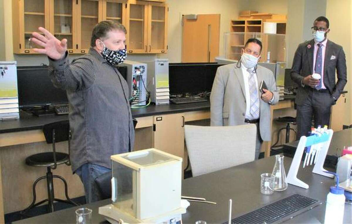 Robert Dixon, a faculty member in SIUE's Department of Chemistry, left, shows off one of the labs to Illinois Department of Commerce and Economic Opportunities deputy directors Julio Rodriguez and Jonathan McGee Friday as part of a two-day tour of the Metro East last week. At SIUE they were looking at a training program for laboratory, chemical and food science technicians.