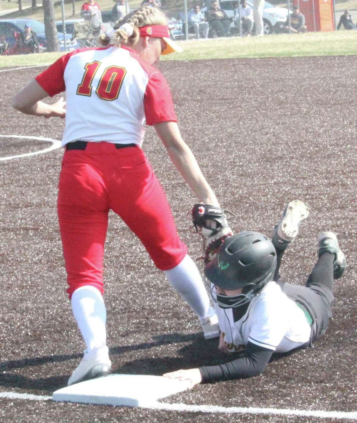Ferris first baseman Kaitlyn Orme tags outa Wayne Staterunner in recent GLIAC action. (Pioneer photo/John Raffel)