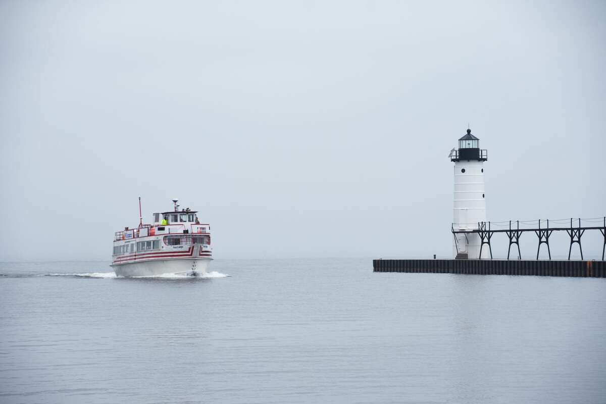 The Princess of Ludington made its way past the First Street Beach lighthouse and through the Manistee River Channel on Friday.