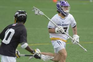 UAlbany's Jake Piseno runs the ball up the field during their game against UMBC on Sunday, April 11, 2021, in Albany, N.Y.   (Paul Buckowski/Times Union)