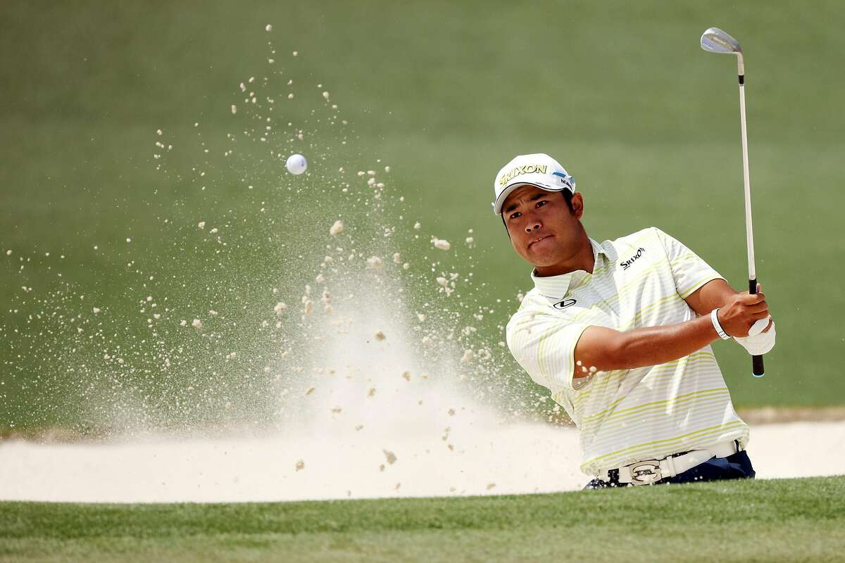 Hideki Matsuyama of Japan plays a shot from a bunker on the second hole during the final round of the Masters at Augusta National Golf Club on April 11, 2021 in Augusta, Georgia.