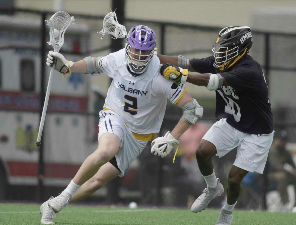 UAlbany's Kyle Casey, left, tries to get around a UMBC defender during their game during the regular season. They will meet again on Thursday in the America East semifinals. (Paul Buckowski/Times Union)