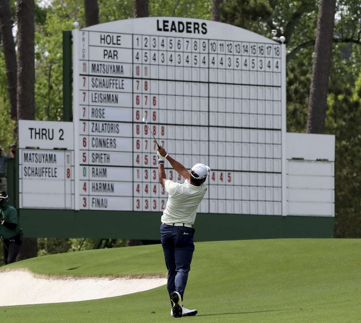 Hideki Matsuyama hits his second shot in the third fairway during the final round of the Masters golf tournament at Augusta National, Sunday, April 11, 2021, in Augusta, Ga.