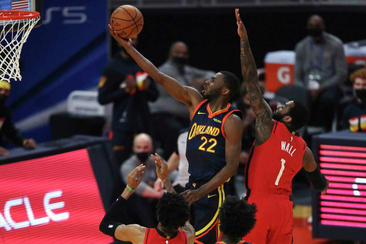 Andrew Wiggins (22) and the Warriors were frequently a step ahead of John Wall and the Rockets in Golden State's 125-109 victory Saturday night.