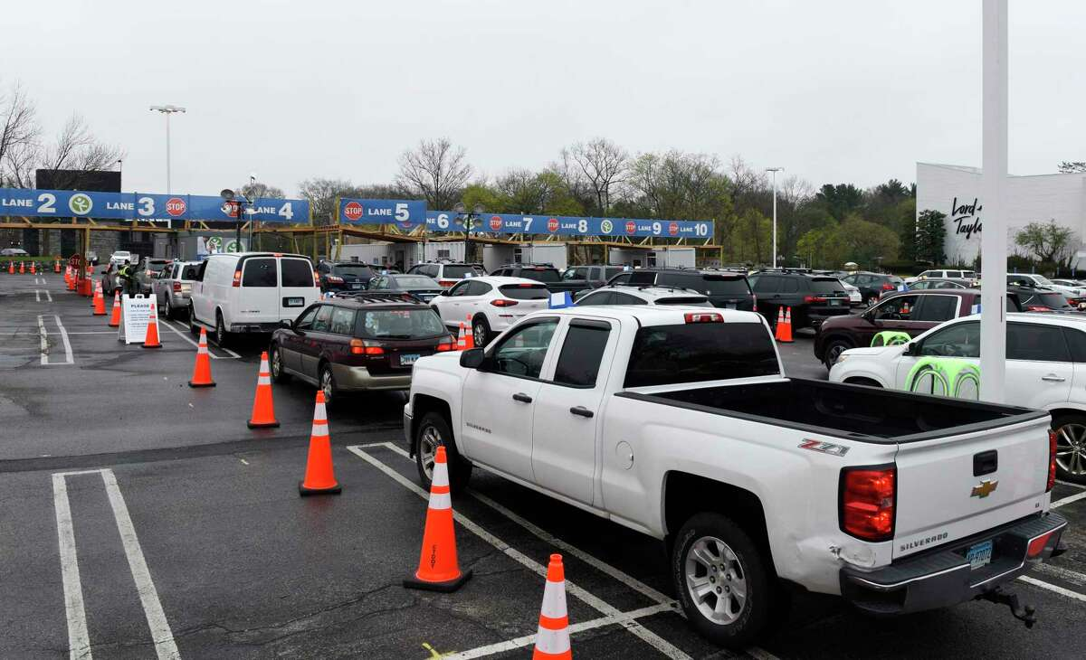 Patients wait in their cars to be vaccinated at the Community Health Center Drive-Thru Vaccination Clinic in Stamford, Conn. Sunday, April 11, 2021. Hundreds of Norwalk Public School students 16 and older received the first dose of the COVID-19 vaccine Sunday at the clinic.