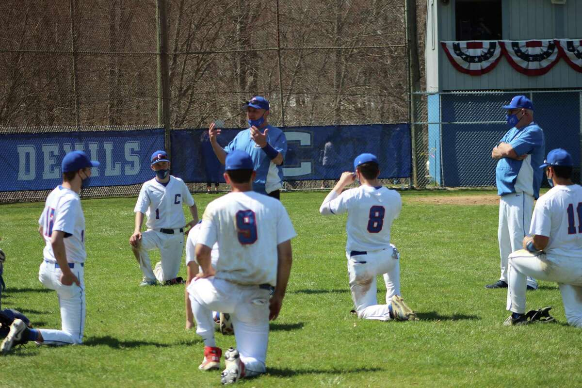 Coginchaug coach Mark Basil gathers his players after Saturday's 14-0 Shoreline Conference win over Portland.