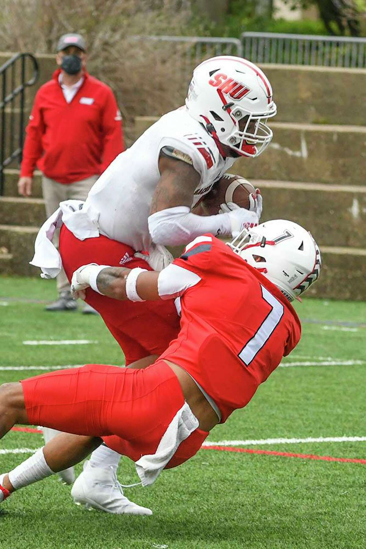Sacred Heart's Julius Chestnut fights for yards during Sunday's win in the NEC championship game against Duquesne.