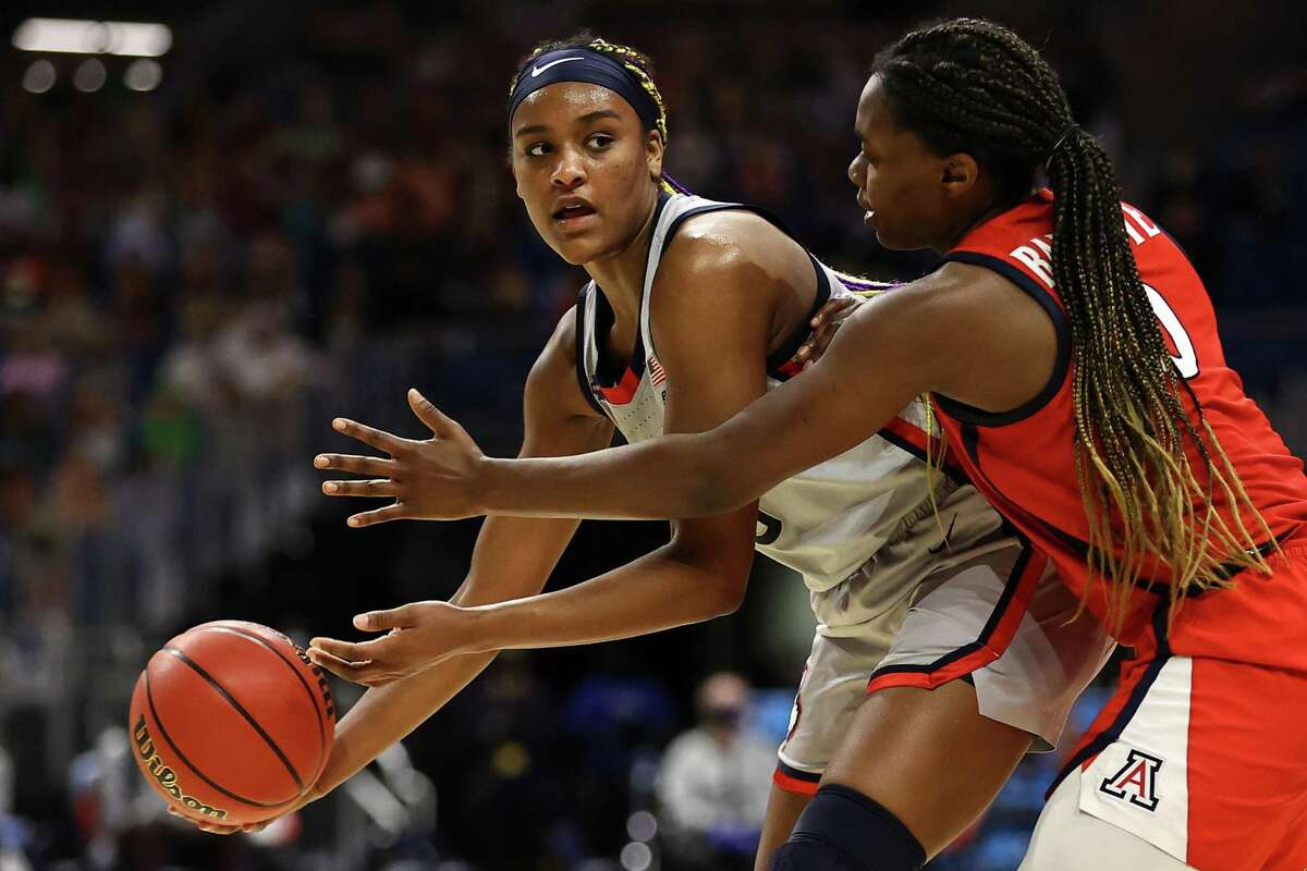 SAN ANTONIO, TEXAS - APRIL 02: Aaliyah Edwards #3 of the UConn Huskies looks to pass around Trinity Baptiste #0 of the Arizona Wildcats during the second quarter in the Final Four semifinal game of the 2021 NCAA Women's Basketball Tournament at the Alamodome on April 02, 2021 in San Antonio, Texas. (Photo by Elsa/Getty Images)