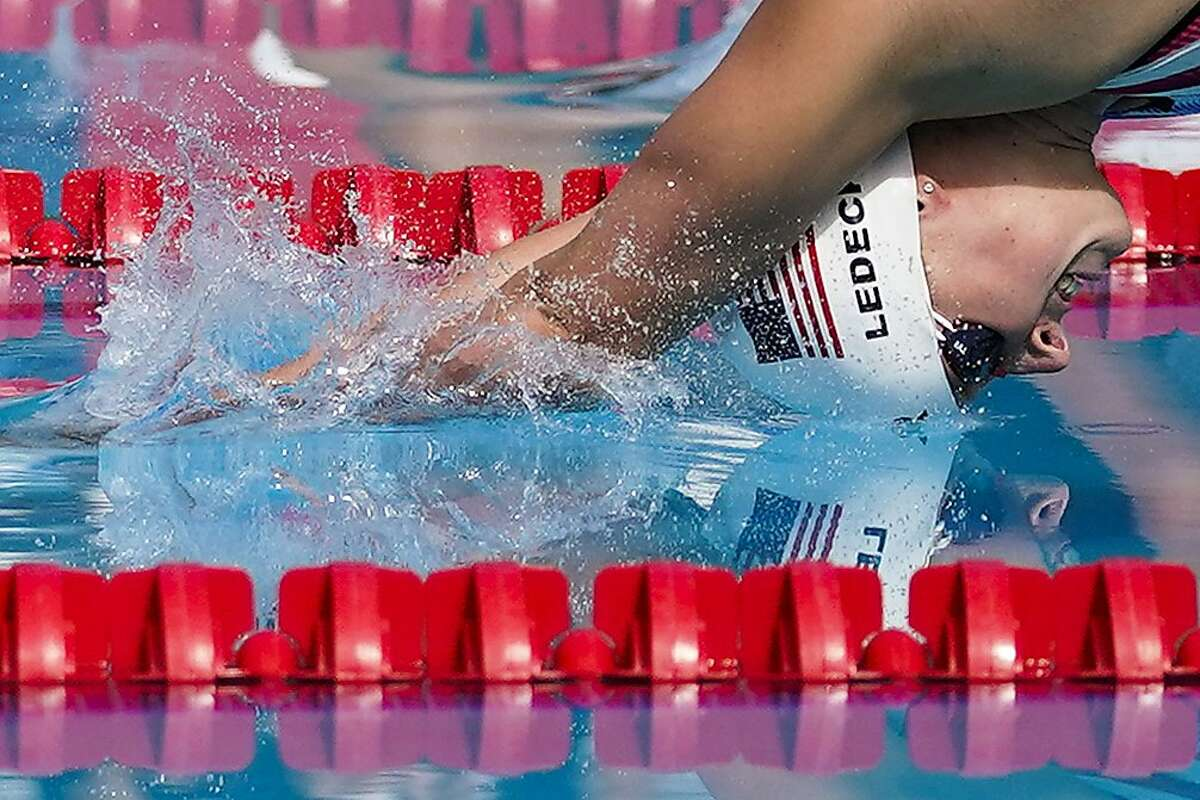 Katie Ledecky dives in to the pool at the start of the women's 1500-meter freestyle final at the TYR Pro Swim Series swim meet Sunday, April 11, 2021, in Mission Viejo, Calif. Ledecky finished first. (AP Photo/Ashley Landis)