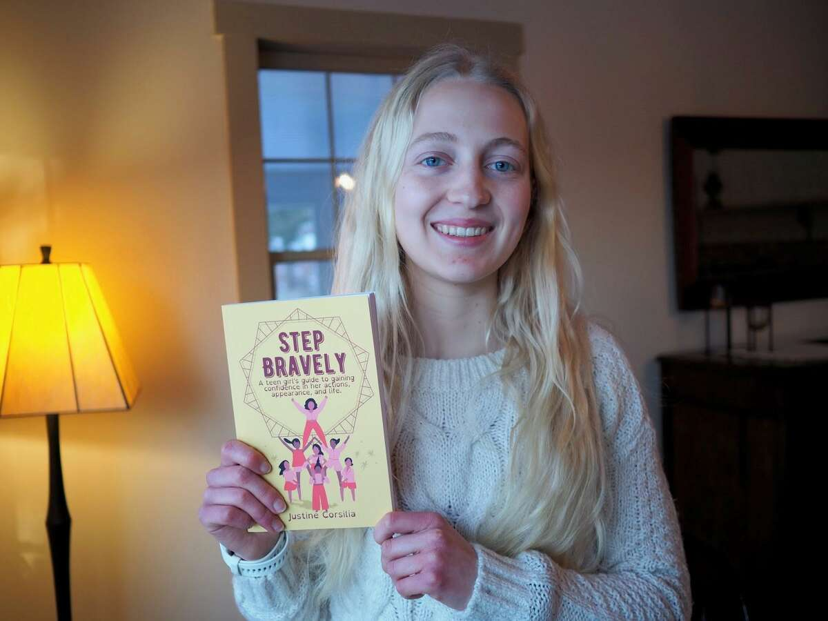 """Ridgefield High School junior Justine Corsilia has self-published a book. The work, """"Step Bravely: A teen girl's guide to gaining confidence in her actions, appearance, and life,"""" is now for sale at Barnes and Noble."""