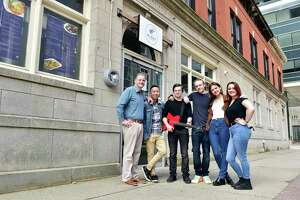 From left, Michael Flora and Kyu Tipjak, owners of the Blue Orchid, a new Pan-Asian restaurant on Court Street in New Haven, with Flora's children Kevin Flora, Michael Flora, Katie Flora and Mikaela Flora